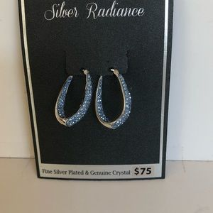 Fine silver plated and blue crystal earrings.